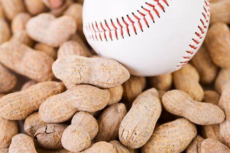 sports shell: Baseball: Baseball Sitting on Peanuts Stock Photo