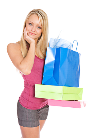 shopper: Shopping: Pretty Shopper Holding The Days Purchases Stock Photo