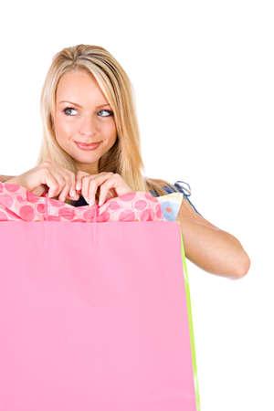 shopper: Shopping: Woman Shopper Glancing to Side Stock Photo
