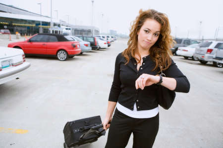 car parking: Travel: Woman At Airport Late For Flight Stock Photo