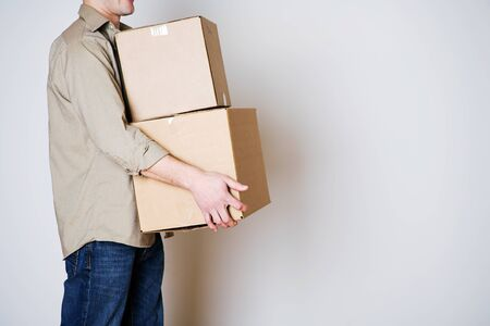Moving: Anonymous Man Carrying Cardboard Moving Boxes Stok Fotoğraf
