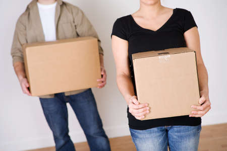 moving box: Moving: Anonymous Couple Each Holding A Box