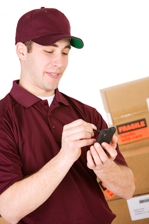 Shipping: Man Checks Shipment On Digital Pad