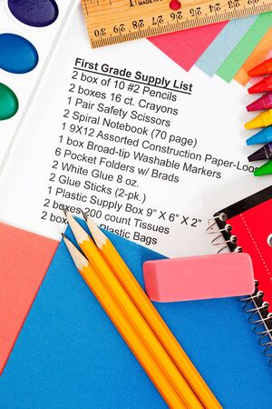 crayon  scissors: Series with school supplies list - pencils, eraser, supply sheet, scissors, paints, etc.  Different items per grade level. Stock Photo