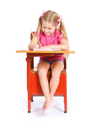 assignment: Student: Young Girl Student Works On Assignment In Notebook