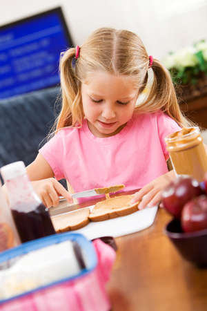 Student: Little Girl Making Her Own School Lunch
