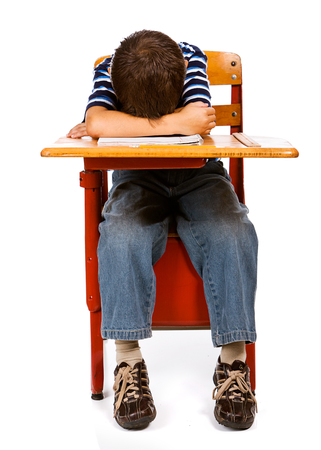 Student: Boy with Head on Desk Stock Photo