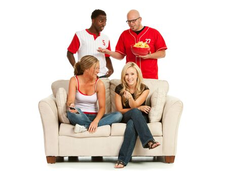 annoyed: Fans: Men Annoyed Women Are On Couch Stock Photo