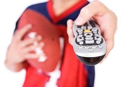 fanatic: Football: Man Pointing TV Remote At Camera Stock Photo