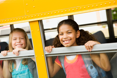 looking out: School Bus: Girls Looking Out Bus Window