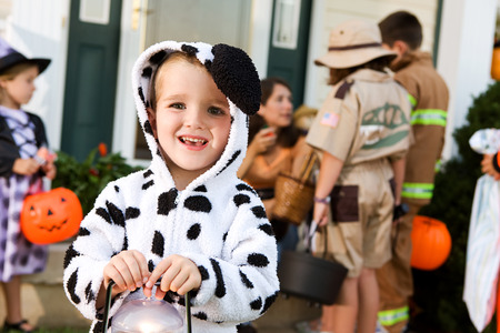 dog in costume: Halloween: Boy In Dog Costume Holds Light