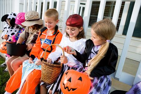 Halloween: Kids Comparing Halloween Candy