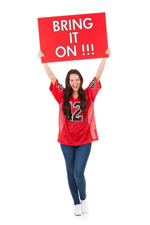 holding aloft: Football: Woman Holding Bring It On Sign Over Head