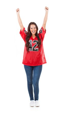 Football: Woman Fan Cheering For Team With Hands In Air Stock Photo