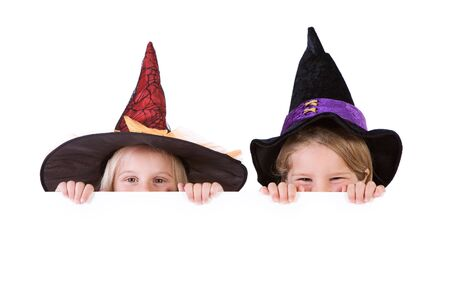 Halloween: Little Girl Witches Look Over White Card