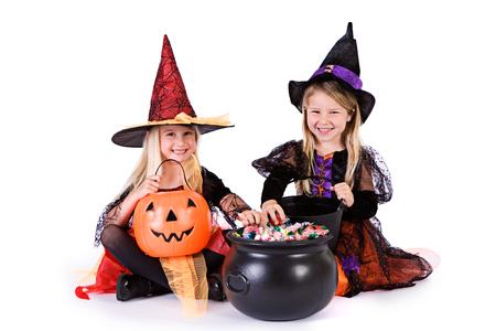 Halloween: Little Girls Ready To Grab Halloween Candy Stock Photo