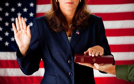 Politician: Woman Taking an Oath on the Bible
