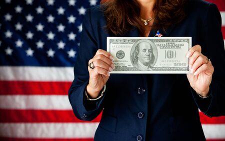 ben franklin money: Politician: Holding a Large Hundred Dollar Bill