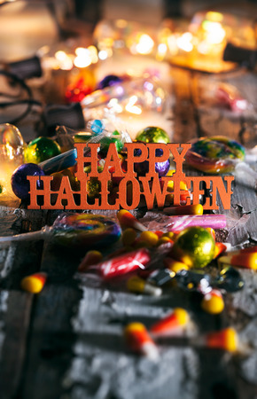 Halloween: Happy Halloween With Candy And Glowing Bulbs Stock Photo