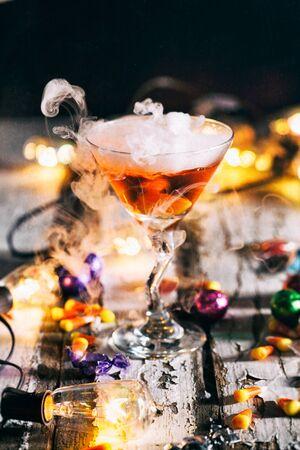 potion: Halloween: Lights Glow Around Orange Potion In Martini Glass