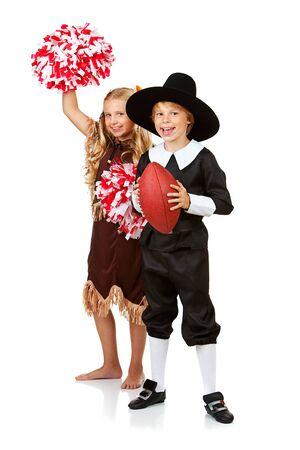 pilgrim costume: Thanksgiving: Pilgrim and Indian are Football Fans Stock Photo