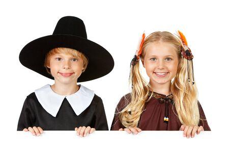 Thanksgiving: Cheerful Thanksgiving Indian and Pilgrim Stock Photo