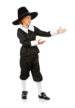 pilgrim costume: Thanksgiving: Boy Pilgrim Gestures to Side Stock Photo