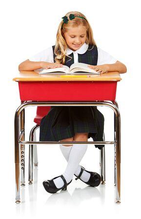 Tudiant: Girl At bureau Livre de lecture Banque d'images - 61861778