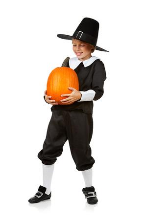 Thanksgiving: Pilgrim Holding Pumpkin