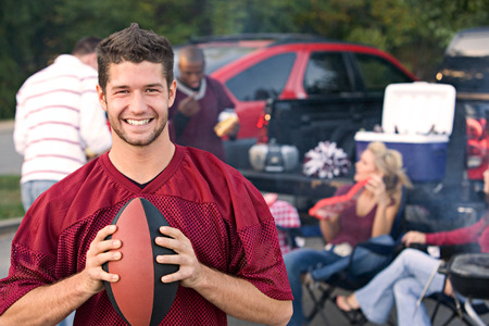 Tailgating: College Student Excited His Team Is Winning The Game Stock Photo - 61861810
