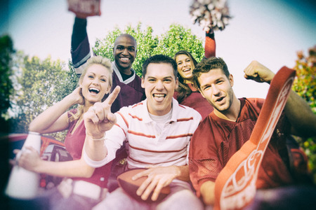 Tailgating: Crazy Groep College Football Fans Stockfoto