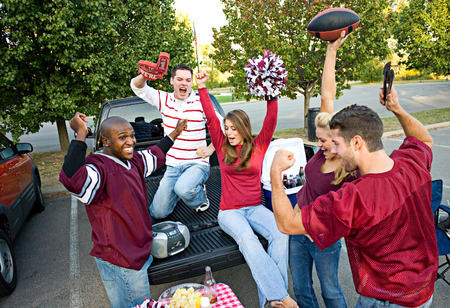 Tailgating: Group Of Friends Cheering While Listening To Football Game On Radio