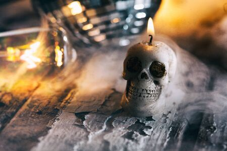mirrored: Halloween: Lit Skull Candle With Mirrored Ball And Spooky Mist Stock Photo