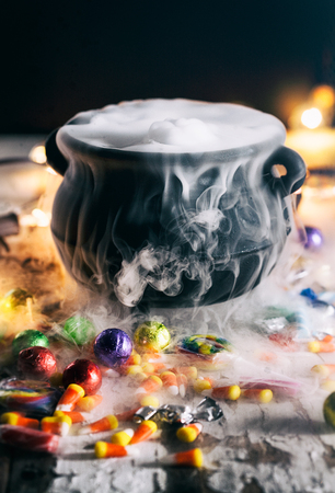 Halloween: Candy Surrounds Cauldron With Magic Potion