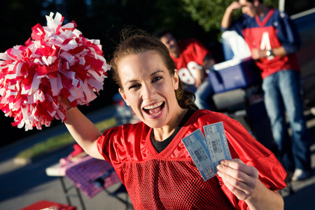 Tailgating: Woman Holding Pair Of Tickets To Football Game