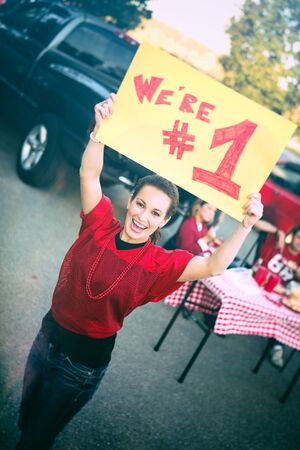 Tailgating: Woman Holds Up Number One Sign For Team