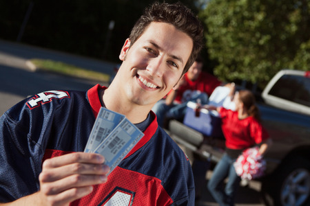 Tailgating: Man Holding Tickets To Football Game