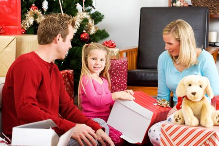 unwrapping: Christmas: Girl Unwrapping Large Gift