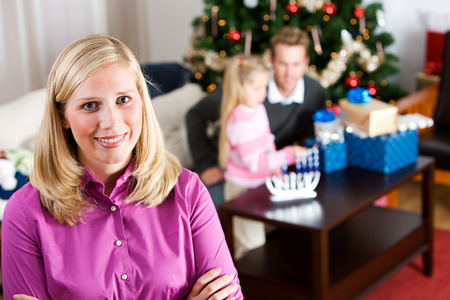 Holidays: Cheerful Mother During Holidays Stock Photo - 63290133