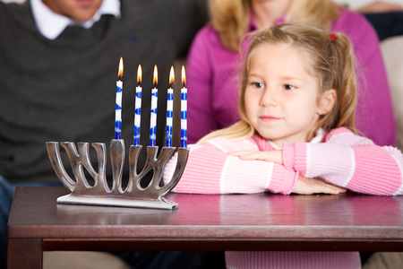 Hanukkah:  Little Girl Looks at Candles
