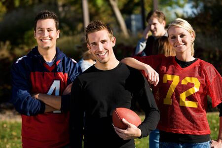 teammate: Football: Group of Football Friends Ready to Play Stock Photo