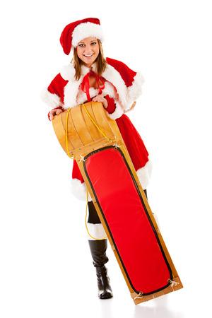 toboggan: Christmas: Santa Girl Holding Toboggan Stock Photo