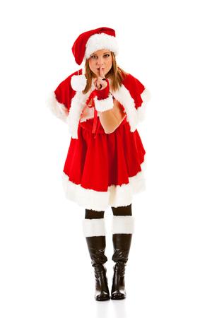 shush: Christmas: Santa Girl Hushing Stock Photo
