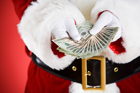 Santa: Holding Out A Money Fan Stock Photo