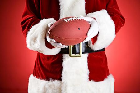 Santa: Holding An American Football