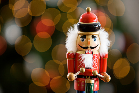 Christmas: Traditional Wooden Nutcracker With Tree Behind Standard-Bild