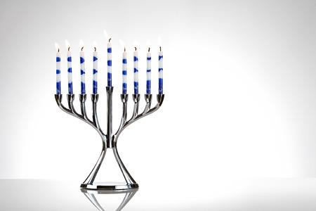 Hanukkah: Menorah With Lit Candles on White Stok Fotoğraf