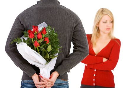 apologize: Valentines: Man Brings Woman Flowers To Apologize Stock Photo