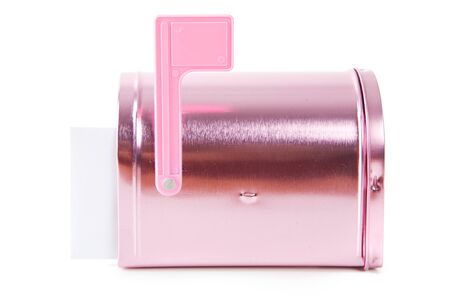A pink Valentine holiday mailbox with various decorations.