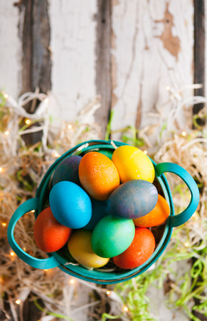 Easter: Pretty Dyed Eggs Sit In Basket On Rustic Background